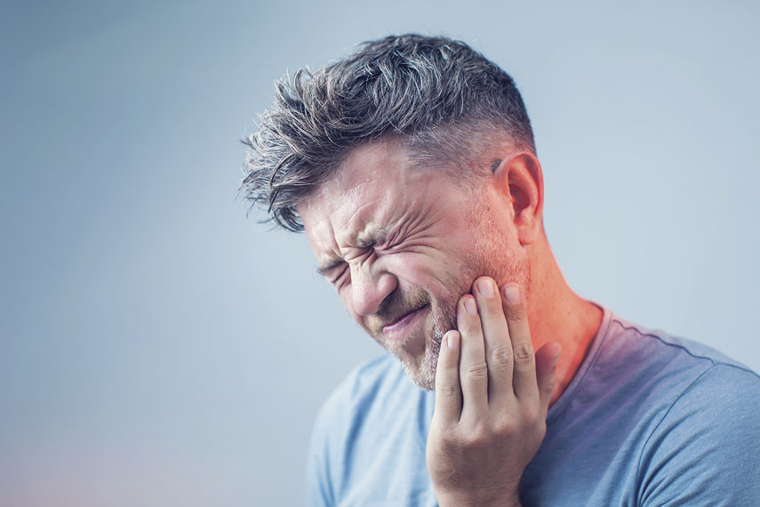 man in pain from tooth