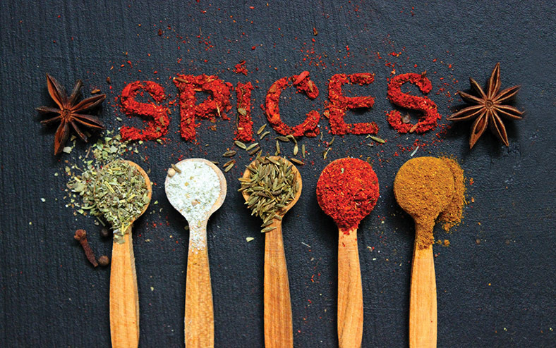 image of spices in wooden spoons cleverly labeled spices