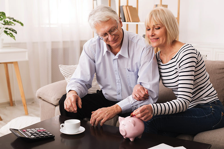 couple looking at financial goals using Education and communication as primary tools.