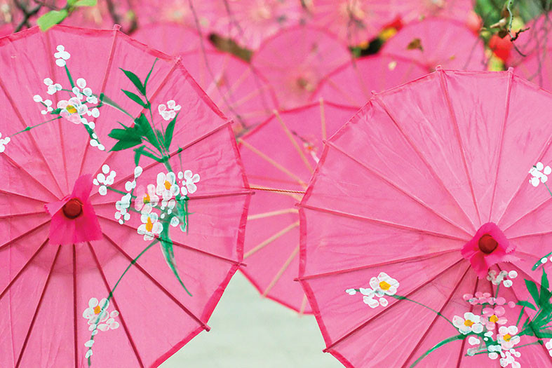 Bright pink umbrellas decorated in a Japanese style