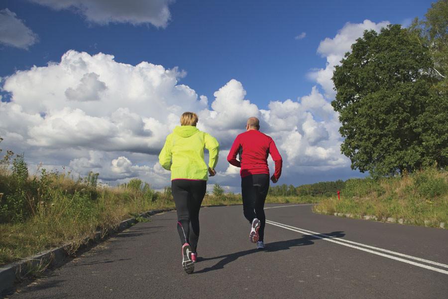 Couple running on road