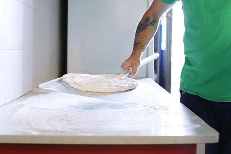 Herstellung der Pizza
