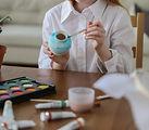 Girl painting an egg.jpg