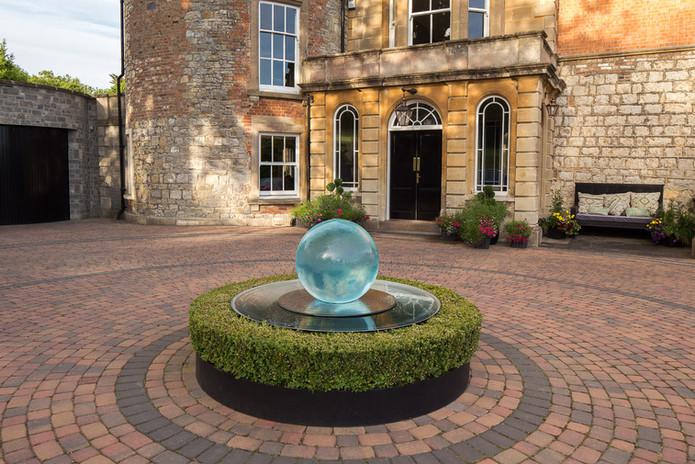 Fountain and front door