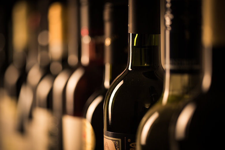 Row of vintage wine bottles in a wine cellar (shallow DOF; color toned image).jpg