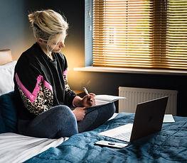 woman writer on bed Jodie Cook_edited.jpg