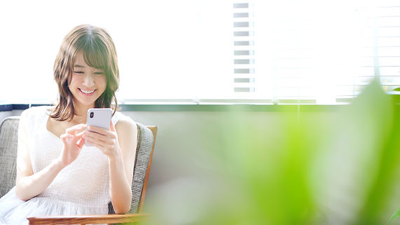 Young asian woman using a smart phone..jpg