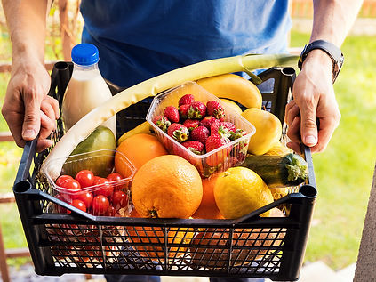 A shopping crate of fresh fruits and vegetables