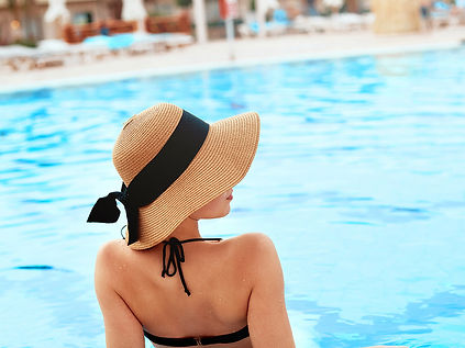 A woman relaxes in pool