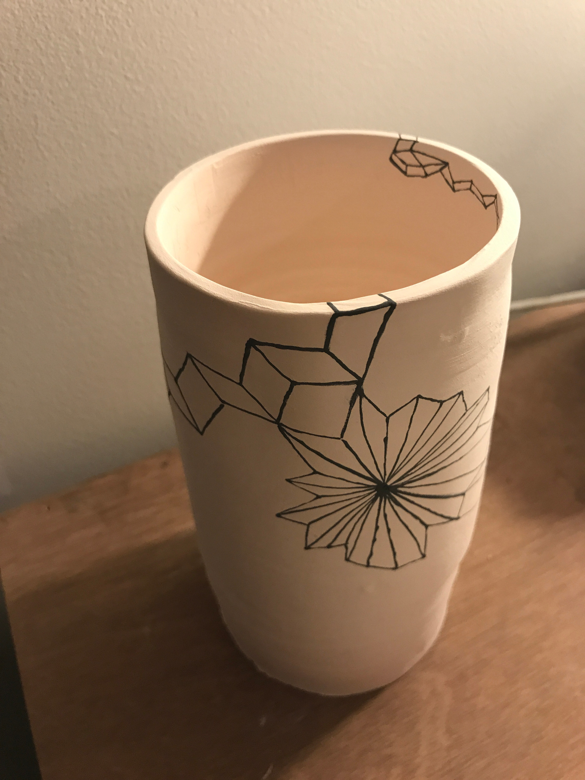 Collaboration with Newtown ceramicist Nicole Gaston (aka Nice Assets). Geometrical designs in perspective on white clay vase. This is a work in progress shot: the vase has not been glazed or fired at this stage.