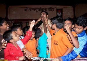 Orphans enjoying Cake