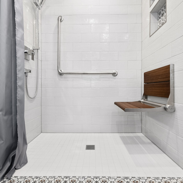 Small powder room to accessible shower transformation