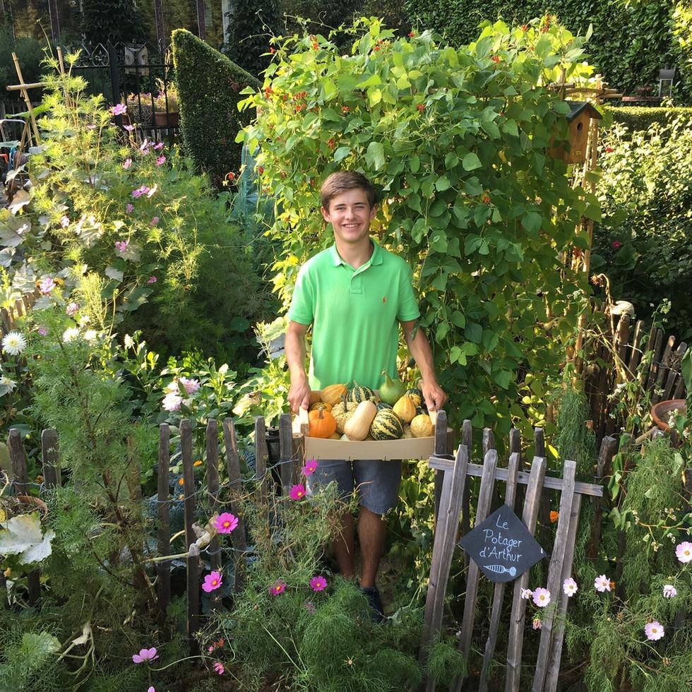 Me in my garden with the pumpkin harvest