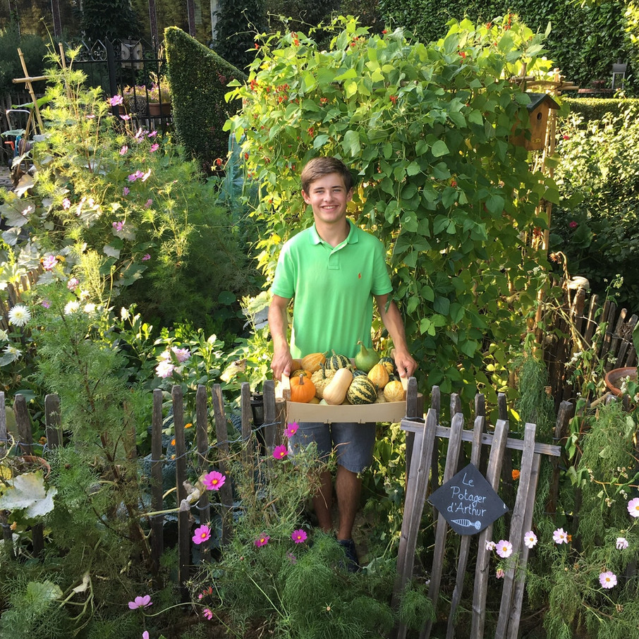 Me in my garden with the pumpkin harvest