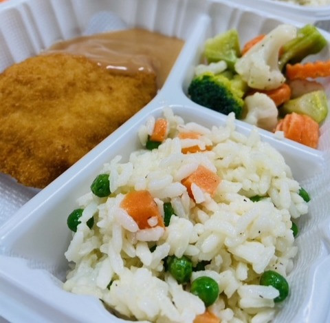 Stuffed chicken cordon bleu with rice and vegetables.
