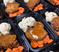 Baked pork with mashed potatoes and carrots.