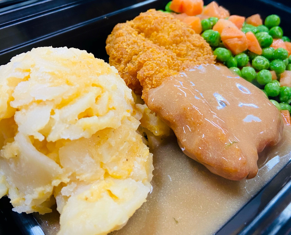 Crispy chicken thigh with scalloped potatoes and peas & carrots.
