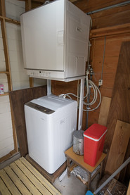 laundry room with gas drier and electric