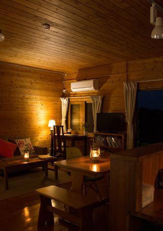 living area phumula cottage at night.jpg
