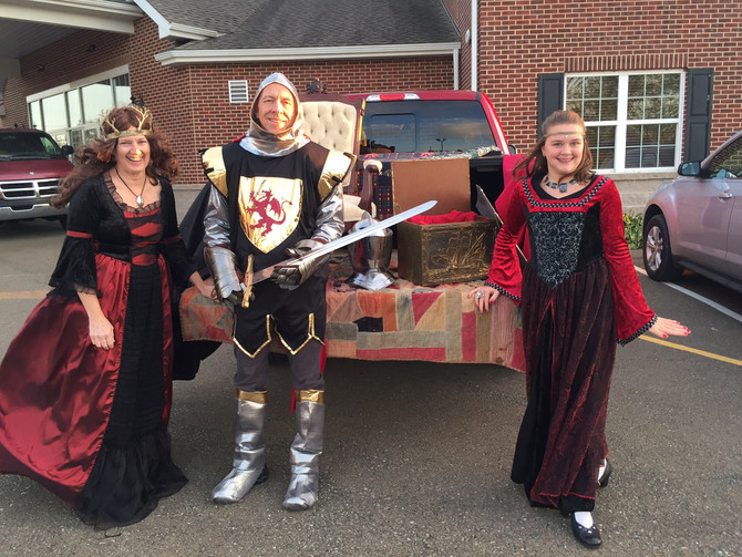 Children come to Trunk or Treat for free candy and fun
