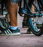 Closeup picture of a bicycle tire and person's foot