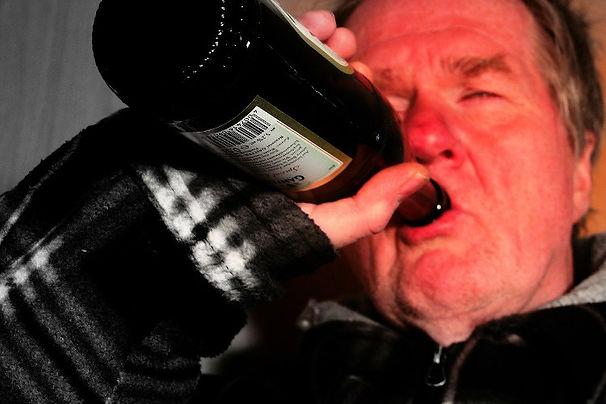 Man drinking from bottle (cropped).jpg