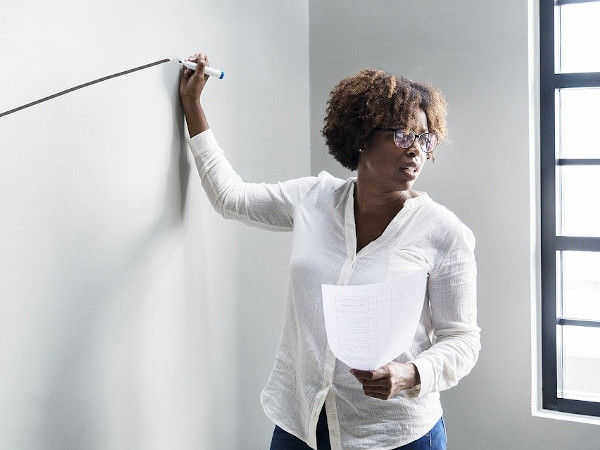 Image of a woman nervously giving a presentation.
