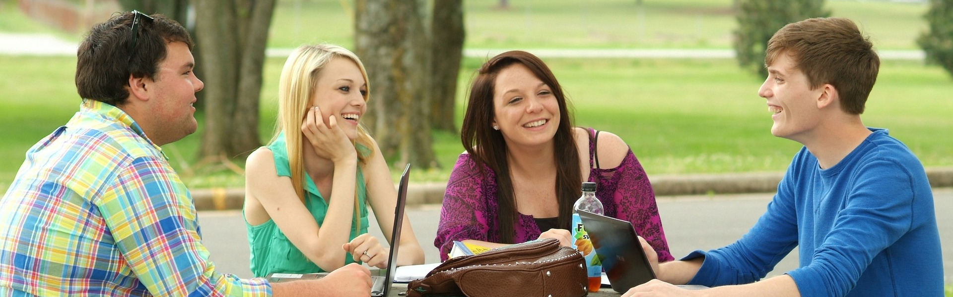 Students sitting at a table outside