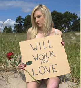 """Picture of a woman holding a rose and a sign that read, """"will work for love"""""""