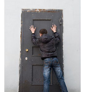 Picture of a man behind a locked door