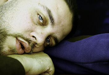 Closeup of a man who appears emotionally exhausted and dejected