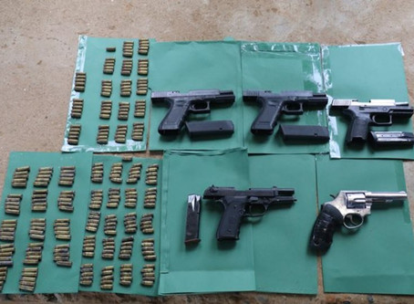 An armoury of guns seized including AK-47 after 14 inmates shot dead in one day