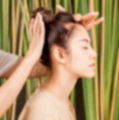 Women is having head massage relaxation