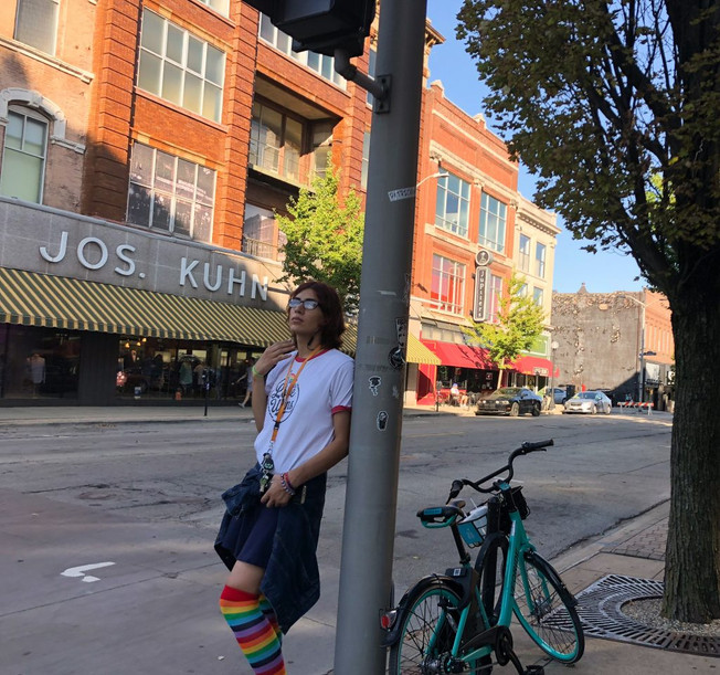 A bystander waits for the 9th annual Urbana-Champaign Pride Parade on September 15, 2018 in downtown Champaign, Illinois. The parade is one of many events that occurs over Pridefest, a weekend long celebration of the LGBTQ+ community in Urbana-Champaign organized by Uniting Pride, an organization that advocates for rights of the LGBTQ+ community.