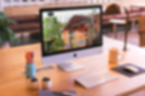 mockup-featuring-an-imac-set-up-on-a-bea