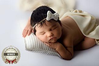 Newborn baby cream and white beanbag posing