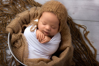 Wrapped Newborn baby in bucket brown shades