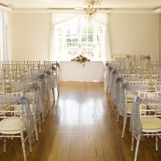 Ceremony room with flower detail for Wedding