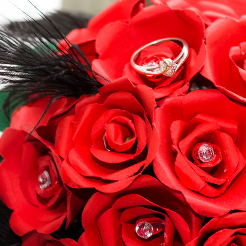 Red and crystal Bridal Flowers with Engagment ring | Panda Creative