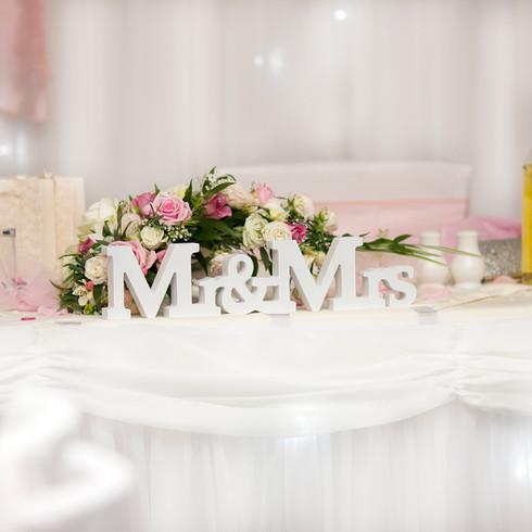White and pink Mr & Mrs wedding top table decor | Panda Creative