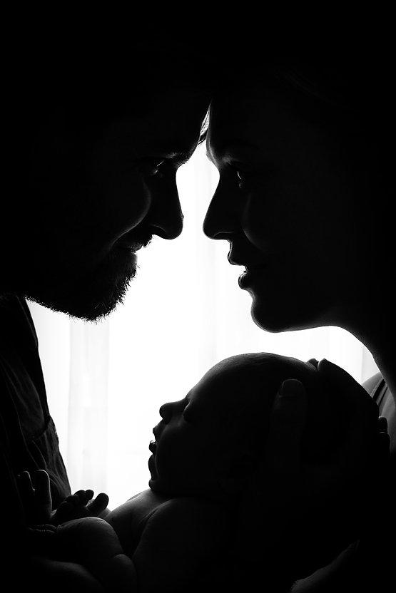 Newborn baby family photo silouette