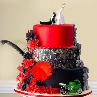 Alternative three teir Wedding cake with rose, lace detail and kawazaki Ninja motorbike