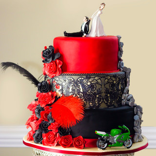 Alternative three teir Wedding cake with rose, lace detail and kawazaki Ninja motorbike
