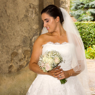 Bride holding Cream and pink rose flowers
