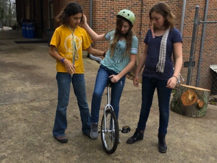 Why do AWS middle schoolers learn to ride unicycles?