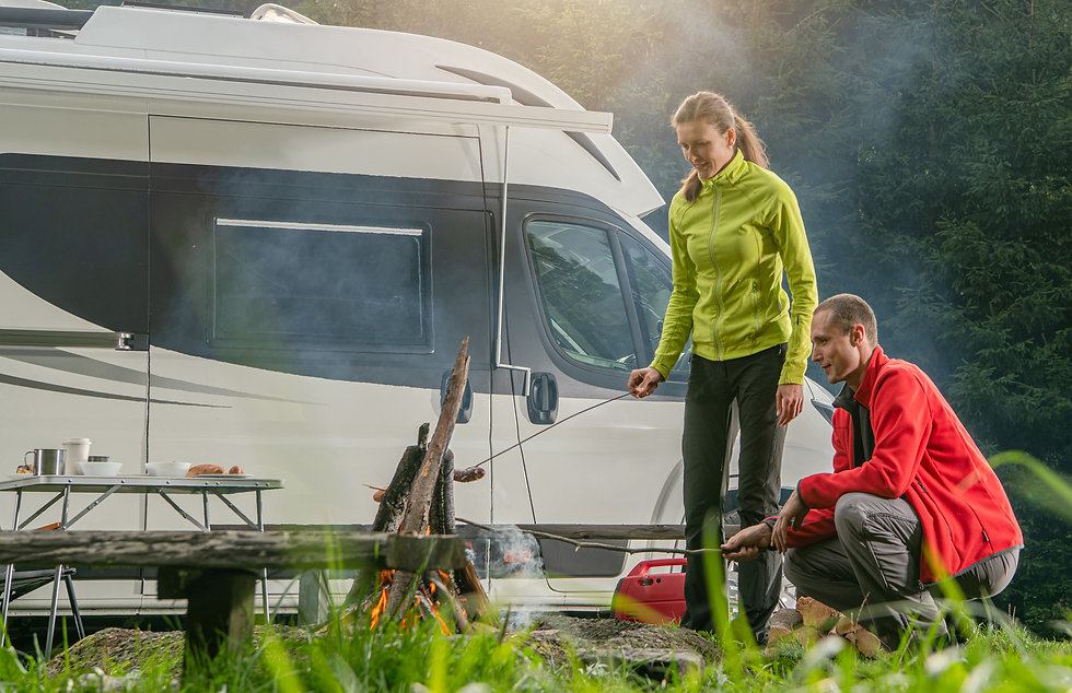 caucasian-couple-rv-park-campfire-fun-PD