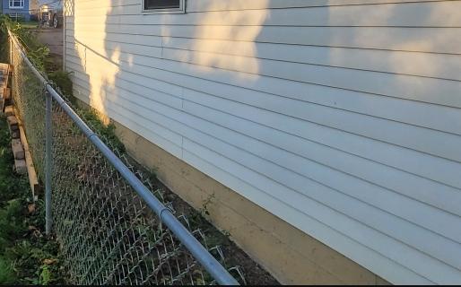 fence close to siding