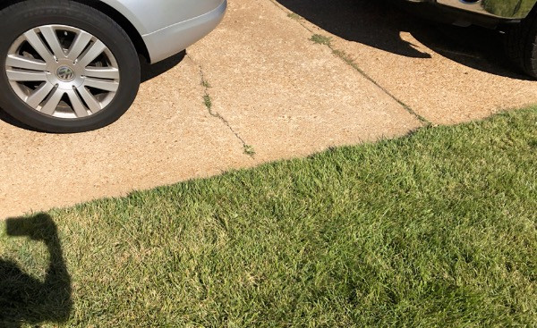 cracked driveway photo taken by a roofing contractor