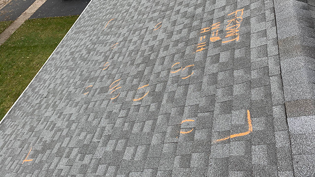 Insurance Roof inspection test square on a shingle roof
