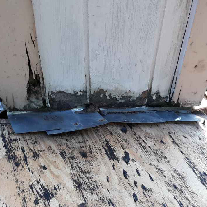 damaged step flashing that needs to be replaced in a roofing supplement